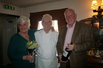 Photo: Dennis and Sue collect their prizes from proprietor Bob, who chose their Cloud III as the car he would like left behind
