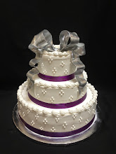 Photo: Wedding cake w/4-dot cluster around sides, traditional top borders, purple satin ribbon wrap around bottoms & silver French ribbon bow topper.