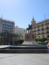 Photo: This was a plaza in Córdoba.  If you look closely, you can see the head of the man on a horse is made of cement as opposed to the metal of the rest of the sculpture.  It was a great centerpiece in the middle of many apartments and stores.