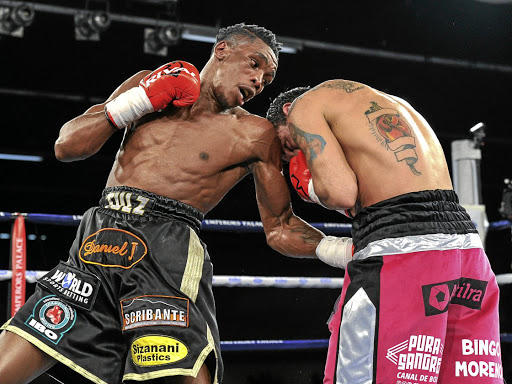 Thulani Mbenge, left, digs a left uppercut on Diego Chaves at Emperors Palace on Saturday night. The Argentinian unfolded in round seven following a vicious right punch.