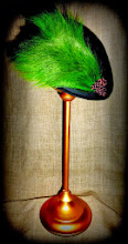 Photo: <KAPELUXE> Unique-Chique Hats by Luba Bilash ART & ADORNMENT  Midnight black wool felt driver's cap; green deer tail; chocolate brown Chinese knots 360 degree possibilities. Can also be worn on an angle. Size XL - 60.5 cm/24 in SOLD