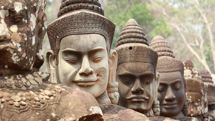 Striking statues at the Angkor Wat temple complex in Cambodia.