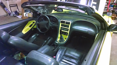 Photo: The interior is about 90% back together. Still not sure I'm going to keep the yellow paint -- definitely want to replace the gauge cluster with a double-din (01-04 model).