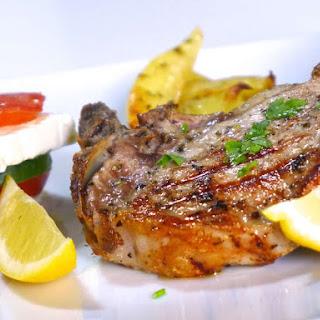 Greek Pork Chops Recipe with Roast Potatoes (Brizola sto Fourno).