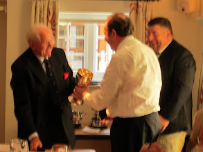 Photo: Frank McCormack receiving the Dragon Club for his work on the new Club Constitution