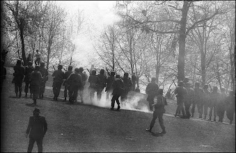 Photo: General Canterbury is the person in the foreground on the left wearing a suit and gas mask.