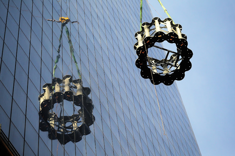 Photo: NEW YORK, NY - DECEMBER 12:  The first piece of the spire is hoisted atop One World Trade Center on December 12, 2012 in New York City.  The first of 18 sections of spire was hoisted atop the 104-story building by crane this morning.  (Photo by Mario Tama/Getty Images)