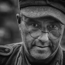 by Marco Bertamé - Black & White Portraits & People ( glasses, cap, ww2, round, soldier, headshot, military, looking, man, portrait, circle, eyes )