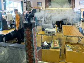 "Photo: 016 Real Smoke effects are very real indeed in 16mm scale – except this isn't smoke at all, it is steam. Alan Eadle has used some electrical trickery with a sealed water unit powered by an electric kettle element to produce this very realistic prolifically ""smoking"" chimney at Ryan's Mill ."