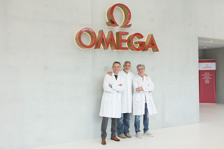 Raynald Aeschlimann, president and CEO of Omega, with George Clooney and Nick Hayek, CEO of Swatch Group
