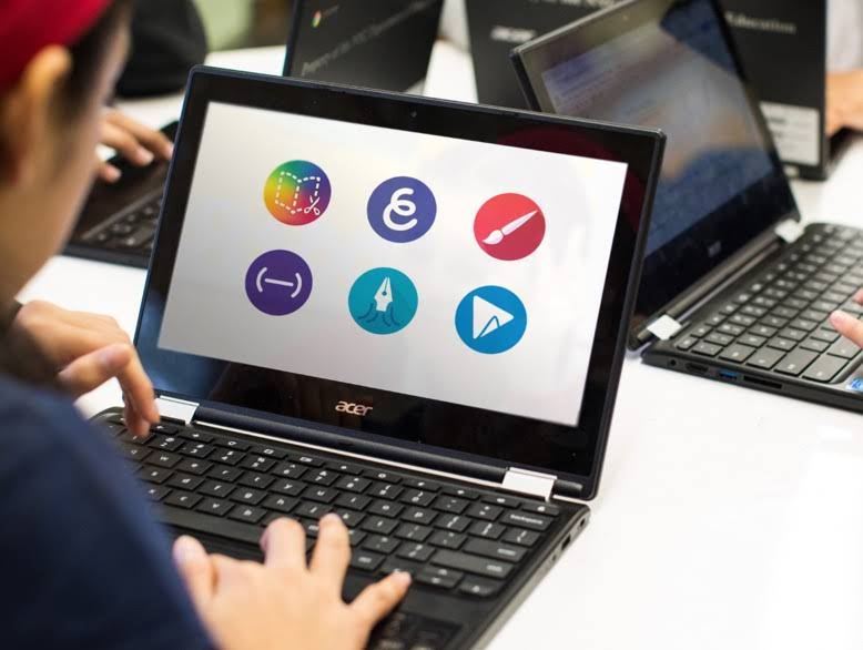 Close up shot of a Chromebook in use with a screen showing the six creativity tools.