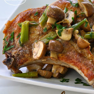 Pork Chops with Mushroom and Onion Gravy.