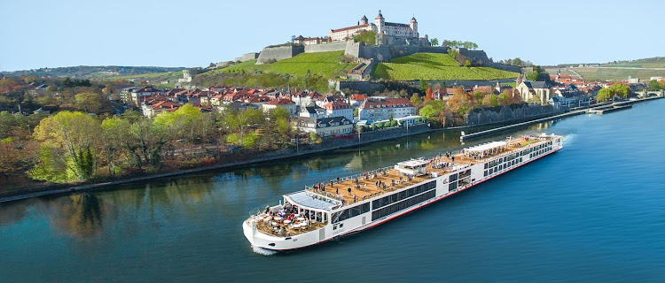 Viking Einar passes historic Marienberg Fortress on the banks of the Main River in Würzburg, Germany.