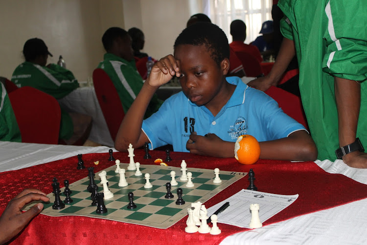 Aguda Lwanga in action during a past national chess league match