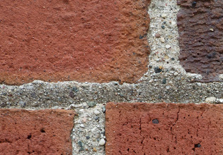 Photo: Upper left corner of a brick wall. Reasonable corner sharpness at F/8. looks better if you apply some sharpening. All tests on Canon 5D Mark III.