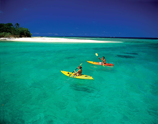 Tonga-kayak-pair.jpg - Kayak the tranquil bays of Tonga on your next cruise to the South Pacific.