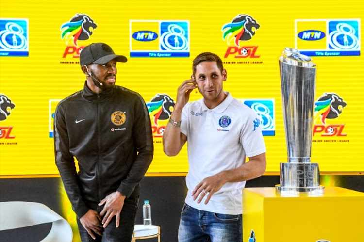 Dean Furman of SuperSport United and Ramahlwe Mphahlele of Kaizer Chiefs during the 2018 MTN8 Launch at Johannesburg Park Station on July 30, 2018 in Johannesburg, South Africa.