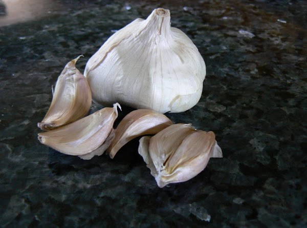 ROASTED GARLIC: Make ahead Preheat oven at 400 degrees. Peel the paper skin away from most...