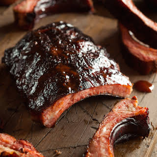 Smoked Pineapple-Braised St. Louis Spareribs with Blackberry Barbecue Sauce.