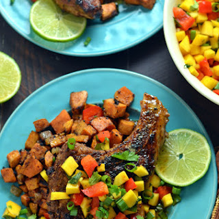 Jamaican Jerk Pork Chops with Curry-Spiced Sweet Potatoes and Mango Salsa.