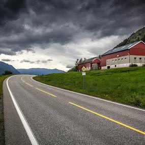 The red farm by Fredrik A. Kaada - City,  Street & Park  Vistas ( stormy, farm, clouds, red, sky, nature, blue, outdoor, dramatic, pop, sun, skies )