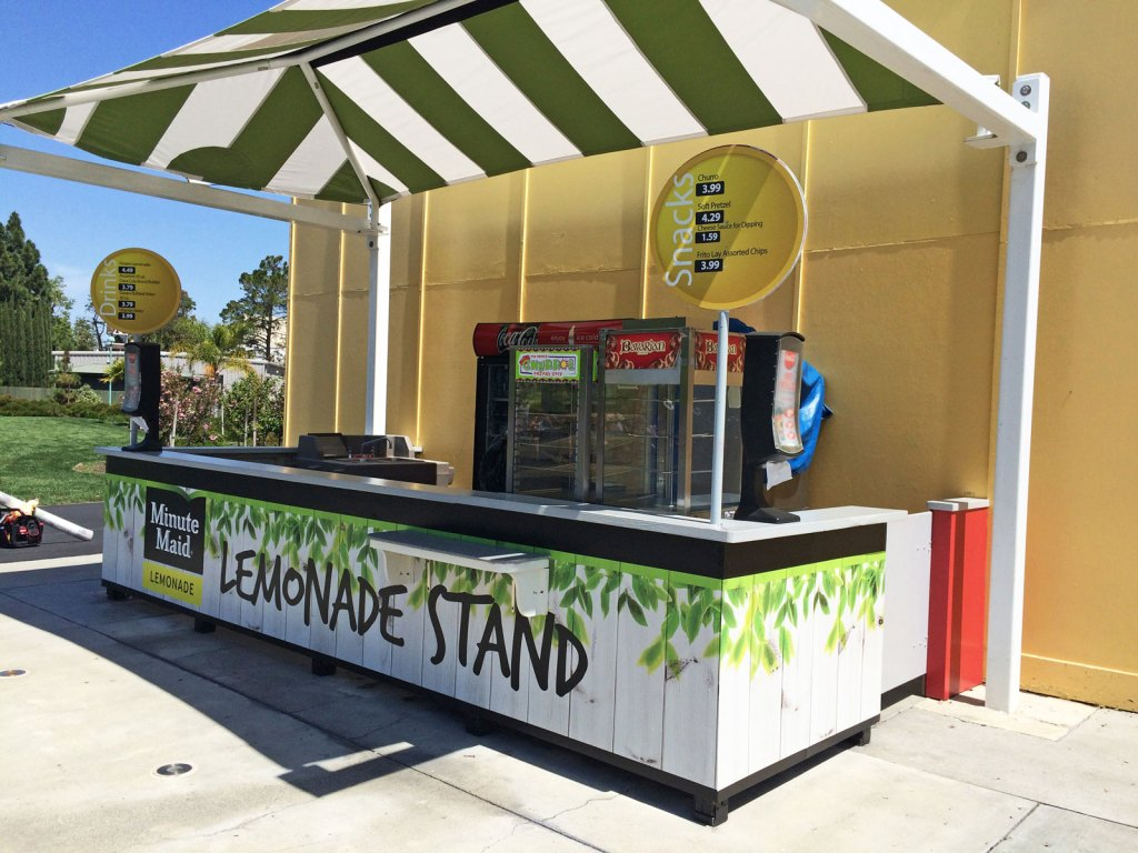 Lemonade stand with large format printing signage