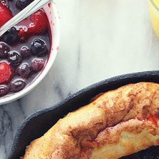 Lemony Dutch Baby with Mixed Berry Sauce