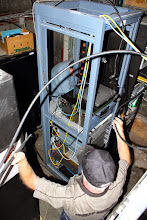 Photo: Garth making the feedline connections behind the rack
