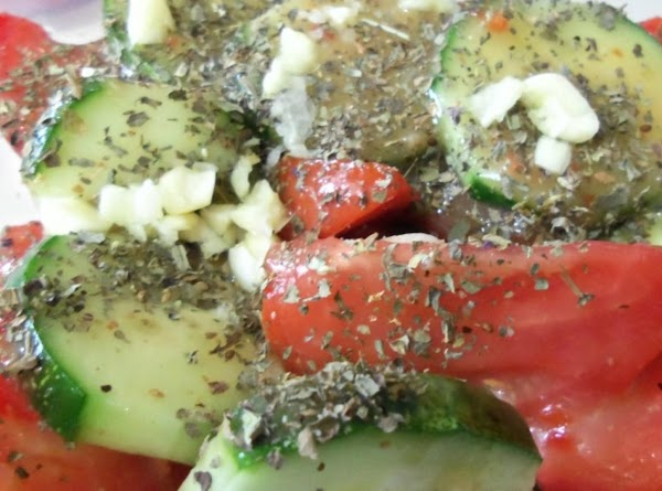 Sprinkle on the basil & minced garlic & pepper flakes, if using.
