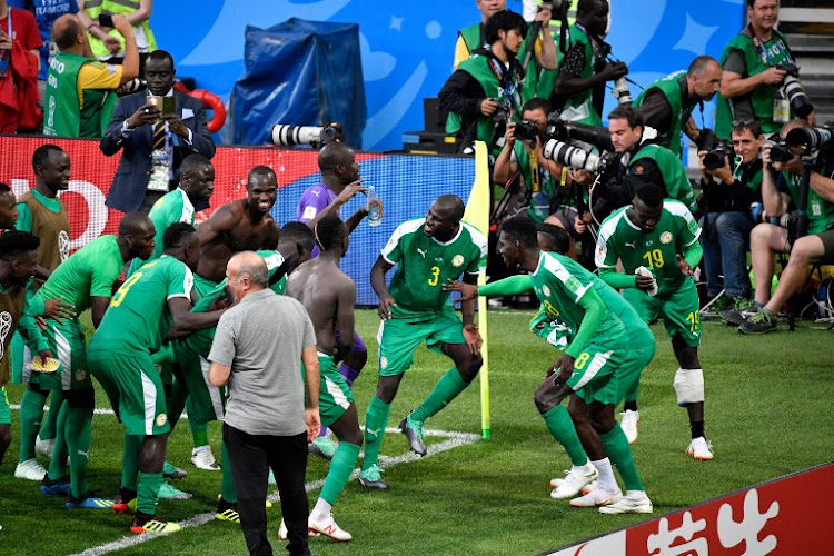 Senegal players celebrate after the final whistle during the Russia 2018 World Cup Group H football match between Poland and Senegal at the Spartak Stadium in Moscow on June 19, 2018.