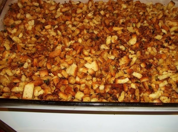 Mix the soup with water. Spread over the cheese.Sprinkle the browned croutons evenly over...