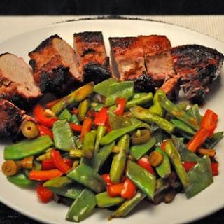 Grilled Pork Tenderloin with Stir-Fried Spring Vegetables.