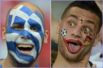 Photo: A combination of pictures made on June 21, 2012 shows a Greek fan (L) on June 16, 2012 at the National Stadium in Warsaw and a German fan on June 13, 2012 at the Metalist Stadium in Kharkiv. Germany will face Greece for the Euro 2012 football championships quarter-finals on June 22 in Gdansk.    AFP PHOTO / GABRIEL BOUYS - PATRIK STOLLARZ