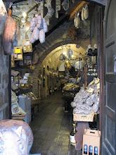 Photo: A sausage shop in Montepulciano's underground.