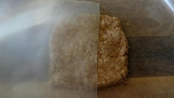 Roll the chilled dough between two sheets of waxed paper. Don't use any extra...