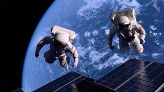 imagen de dos astronautas en el espacio