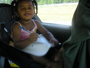Photo: Kaleya writing in the car.