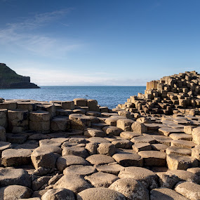 Giant's Causeway, County Antrim, Northern Ireland by Paul Krug - Landscapes Travel ( skyline, ireland, mountain, ulster, stone, rock, antrim, heritage, geology, sky, nature, northern ireland, causeway, stepping, national, tourism, quiet, coastal, unesco, county antrim, northern, landmark, county, hexagonal, basalt, natural, shore, europe, ocean, north, volcanic, giant's causeway, coastline, landscape, united kingdom, coast, kingdom, formation, water, united, uk, reef, sea, scenic, seascape, lava, blue, scenery, giant )