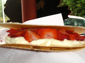 "Photo: This is an ""oblea"", a delicious Colombian treat. You put one wafer on the bottom, cover it in ""dulce de leche"" (similar to caramel), then another wafer layer to seal it in. Then cover that wafer with fresh cream, sliced fruit (strawberries are an excellent choice), and then finally another wafer to top it off. Yum!"