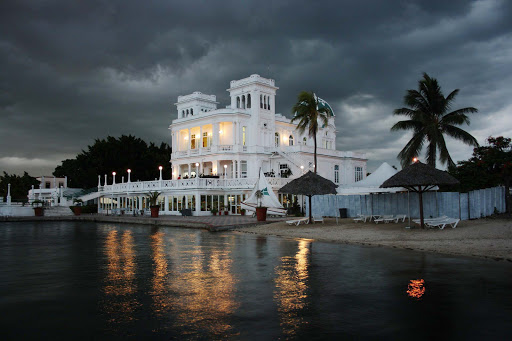 A pretty building in Cienfuegos, Cuba, at nightfall as a storm approaches.