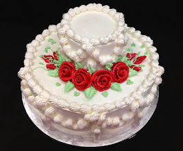 Photo: Traditional wedding cake w/red frosting froses.