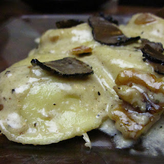 RAVIOLI WITH WALNUT TRUFFLE CREAM SAUCE.