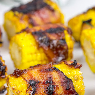 Bacon Wrapped Corn with Honey BBQ Sauce.