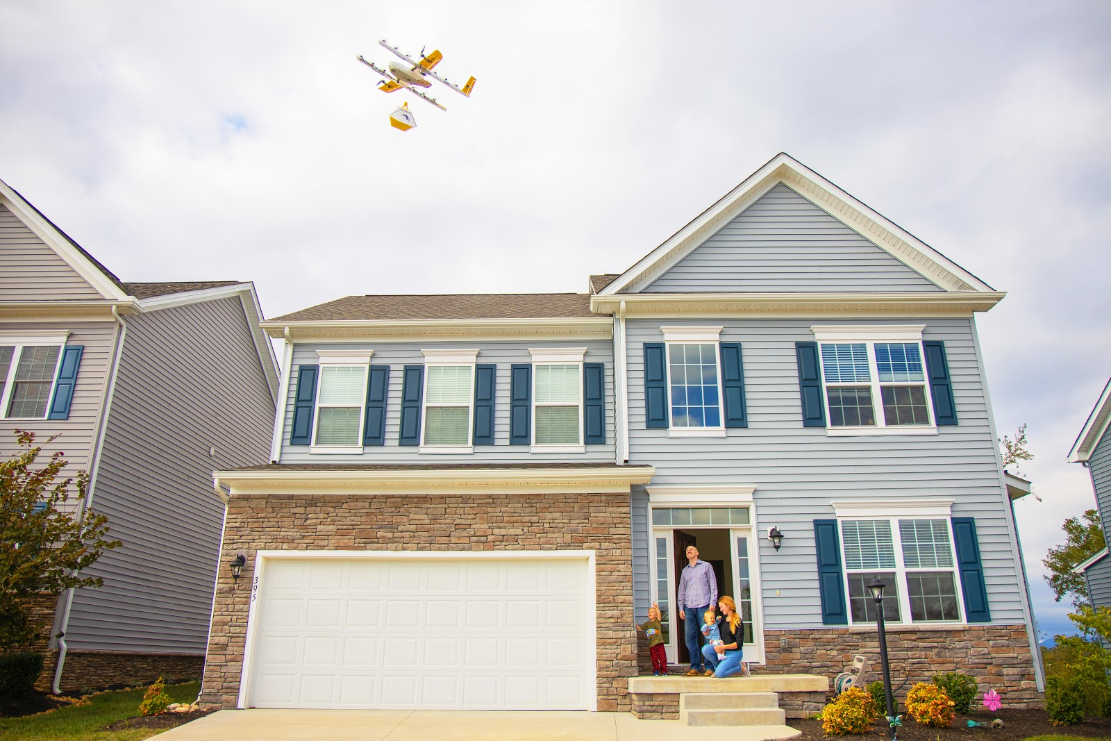 A family in Christiansburg, Virginia receiving a drone delivery from Wing