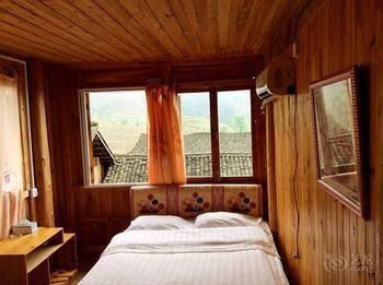 Longsheng Zhaihualou Inn