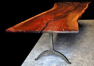 Photo: http://dorsetcustomfurniture.blogspot.com/2013/08/a-claro-walnut-slab-table.html
