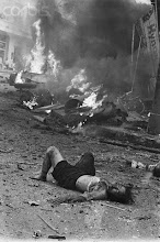 Photo: 30 Mar 1965, Ho Chi Minh City, Vietnam --- Original caption: Saigon, South Vietnam: A dead woman lies among flaming debris of the American Embassy after a terrorist bomb rocked the building and surrounding area wounding and killing an estimated 50 persons. --- Image by © Bettmann/CORBIS