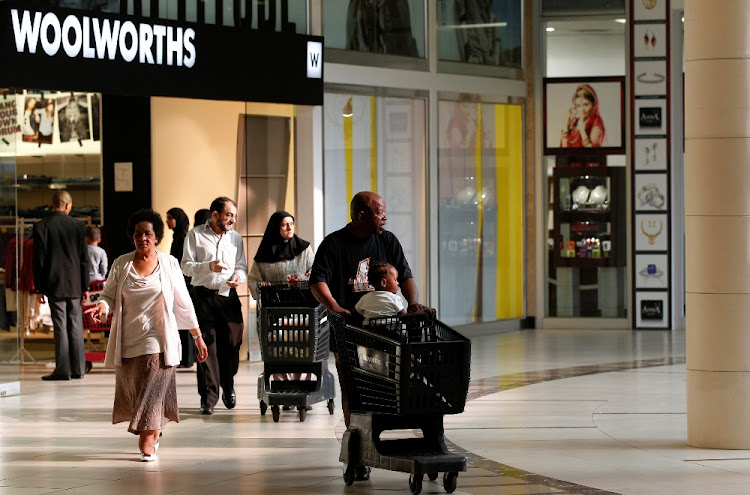 Shoppers leave a Woolworths store in Lenasia, south of Johannesburg. Picture: REUTERS