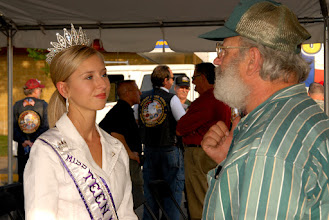 Photo: Miss Teen Minnesota 2008 Megan Harackhoff chats with a Vietnam veteran during a fundraising event  hosted by Minnesota Assistance Council for Veterans at Canterbury Park in Shakopee, Minn.