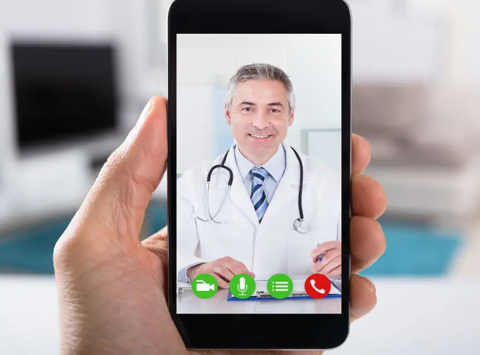 A doctor interacting with his patient via telemedicine mobile app.